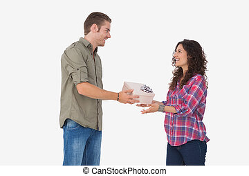 Man offering his friend a present