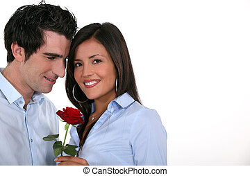 man offering his girlfriend a rose