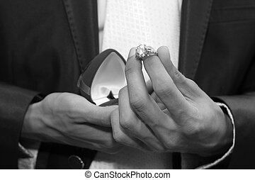 wedding ring - Man offers wedding ring in a red box