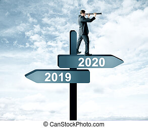 Man on 2019, 2020 sign