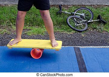 Balance board - Man on a Balance board in a local circus.