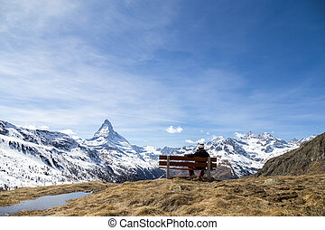 Man on a bench with Matterhorn view