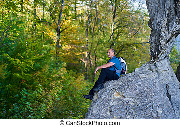 Man on a cliff in the mountains