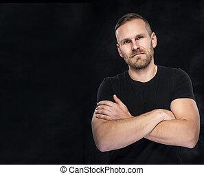 Man on a dark background.