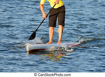 man on a paddle board in ocean