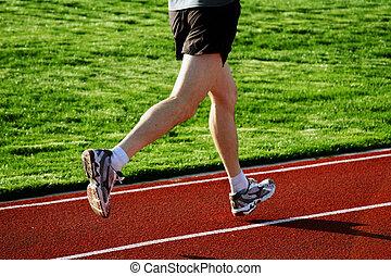 Man running on a racetrack