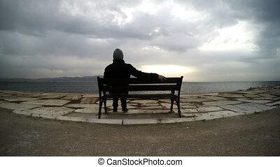 Man on a Seat near the sea