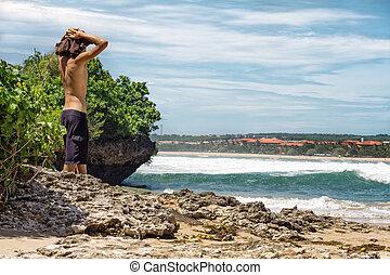 Man on a wild tropical beach
