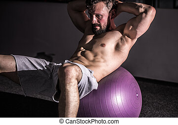 Man on an exercise ball