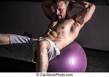 Man on an exercise ball