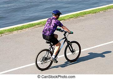 man on bicycle - adult man riding on mountain bicycle