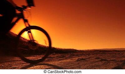 Man on Bike at Sunrise