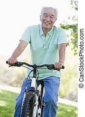 Man on bike outdoors smiling