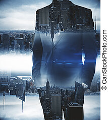 Man on blue city background