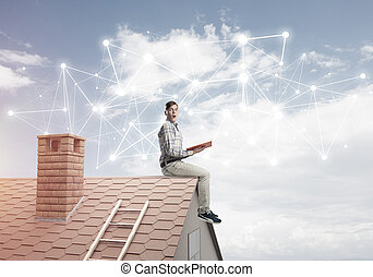 Man on brick roof reading book and concept of social connection