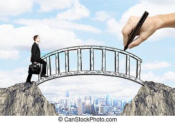 Man on bridge - Success concept with hand drawing bridge...