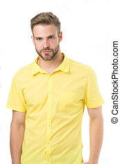 Man on calm face posing confidently in cotton shirt, white background. Fashion concept. Man looks attractive in casual yellow linen shirt. Guy with bristle wears casual or formal wear