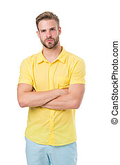 Man on calm face posing confidently with folded arms, white background. Man looks attractive in casual yellow linen shirt. Guy with bristle wears casual or formal shirt. Fashion concept