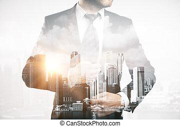 Businessman on city background. Double exposure