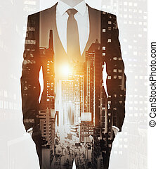 Front view of businessman in suit on abstract city background with sunlight. Double exposure