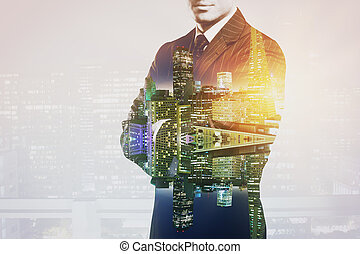 Man on city background multiexposure