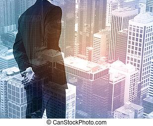 Man on city background - Thoughtful businessman on city...