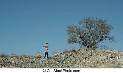 Man On Cliff Signaling