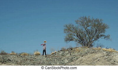 Man On Cliff Signaling