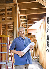 Man on construction site.