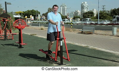 Man on elliptical cross machine