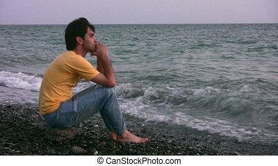 Man on evening beach
