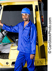 man on forklift - african man getting of a forklift