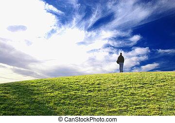 Man on green grass - man standing on green grass