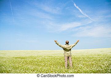 Man on green meadow.