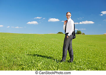 Man on green meadow