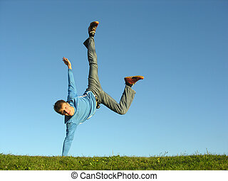man on hands on blue sky 2