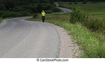 Man on highway slowly run