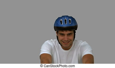 Man on his bicycle on grey screen in slow motion