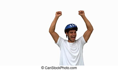 Man on his bicycle raising arms on