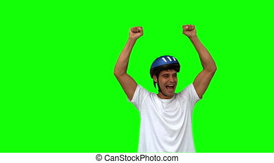 Man on his bicycle raising arms