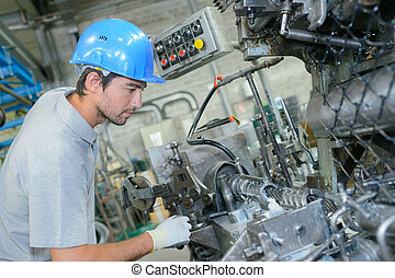 Man on industrial production line