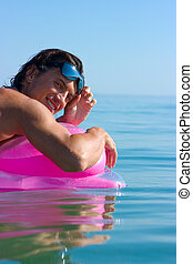 Man on inflatable raft - Muscular handsome man in sunglasses...