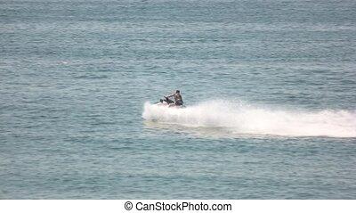 Man on jet ski. Summer water extreme. Entertainment at sea.