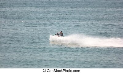Man on jet ski. Summer water extreme. Entertainment at sea.