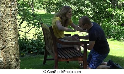 Man on knees apology his woman after quarrel at home. 4K