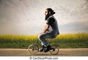 Man on mini bike - Man riding mini bike