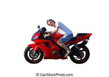 Man without a helmet wearing short pants rides a beautiful red motorcycle on a residential street - isolated, can superimpose over a background image.
