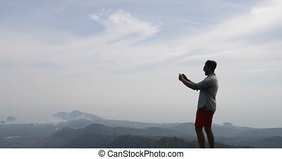 Man On Mountain Top, Male Tourist Taking Photo Of Morning...