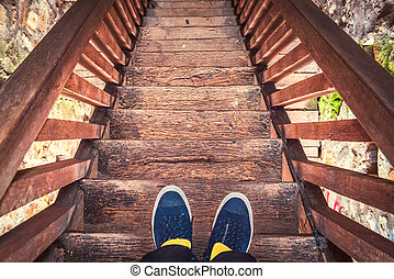 Man on old wooden stairs
