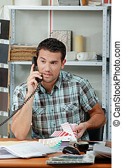 man on phone in office